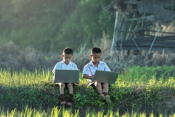 Why are there fewer women in Tech - Two boys using Computer